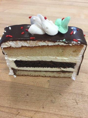 Single slice of Black and White Cake