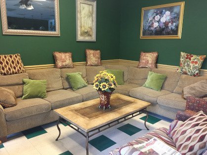 couches and coffee table to lounge at the bakery shoppe
