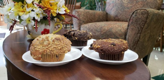 Muffins on the coffee table in the lounge at The Bakery Shoppe in Huntersville, NC