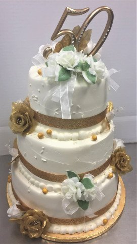 3 Tier Cake for 50th Anniversary with gold trim and flowers